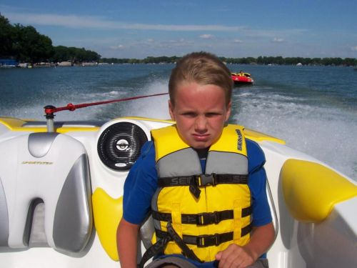 kids tubing, one left out grumpy!